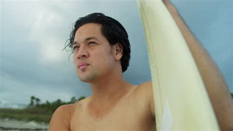 rugged asia up rugged asian surfer living healthy outdoor lifestyle holding his