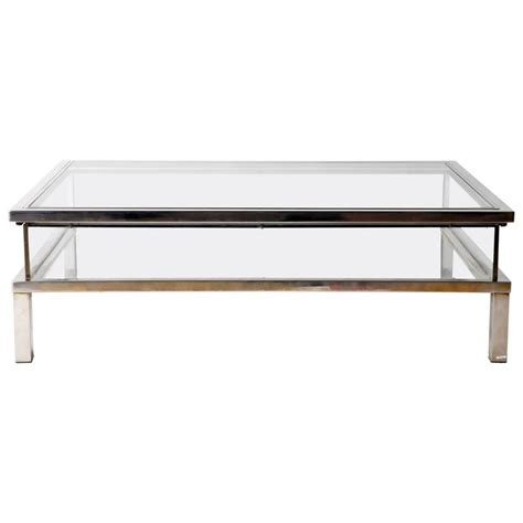 vintage sliding glass top coffee table attributed to