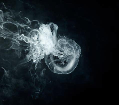 vape trick jellyfish  black background close  stock