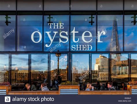 Oyster Shed Pub by City Of Workers Enjoying A Drink After Work The