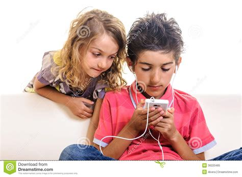 boys chat children chat browsing cell phone royalty free