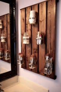 Rustic mason jar board is great for keeping makeup brushes in check