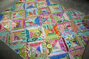 fibers bright colored scrappy quilt finished