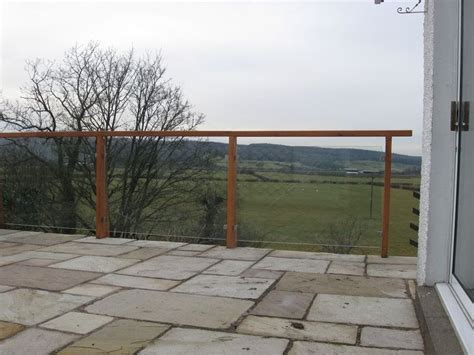 Stone Patio Terrace with Glass Balustrade and Timber and