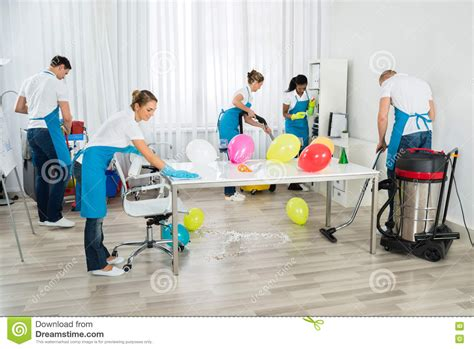 party clean janitors cleaning the office after party stock photo
