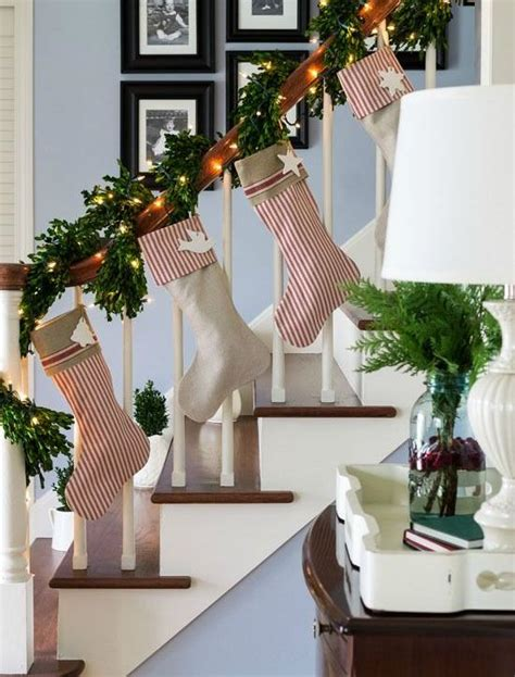 garland hangers for banister 37 beautiful christmas staircase d 233 cor ideas to try digsdigs