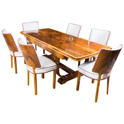 antique deco burr walnut dining table and six chairs
