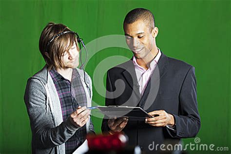 Studio Floor Manager by Presenter And Floor Manager In Tv Studio Stock Photography
