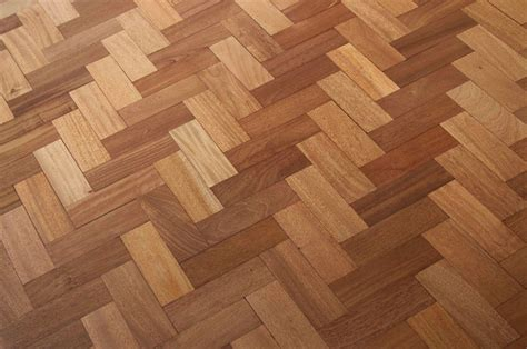 reclaimed herringbone sapele parquet fitting and sanding
