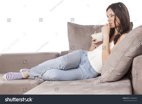 woman eats couch beautiful young woman sitting on couch stock photo