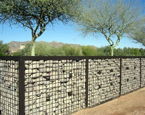 gabion wall with river rock fences pinterest gardens