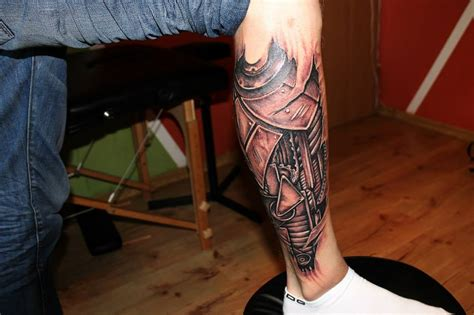 leg tattoo for men grey ink biomechanical leg for