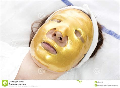 Pibamy Gold Mask Pibamy Time Gold Mask gold mask on purple silk fabric stock photo cartoondealer 29465142