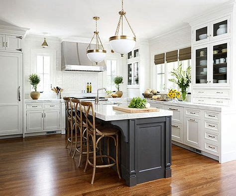 white kitchen cabinets with gray kitchen island