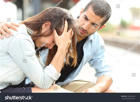guy comforting girl side view muslim man comforting sad stock photo 289596209