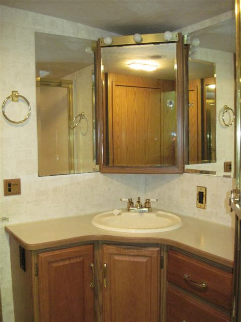 delightful Bathroom Mirror Ideas For Double Vanity #4: Glossy-Corner-Bathroom-Vanity-Adelaide-with-Brown-and-Bright-Touches-at-Modern-House-Concept.jpg