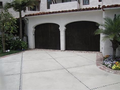 Driveway Garage Transition by Creative Concrete Upgrades Landscaping Network