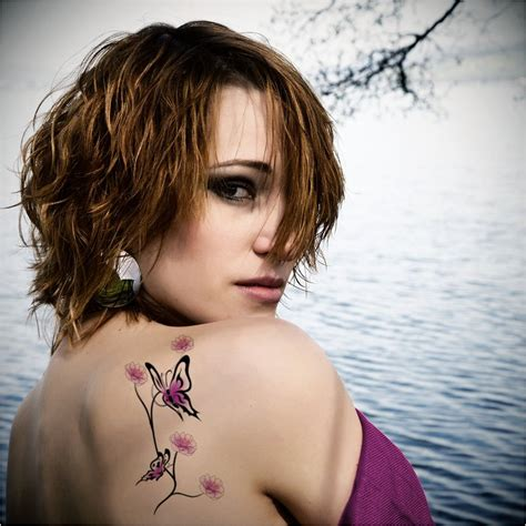 butterfly shoulder tattoos sports flying butterfly tattoos
