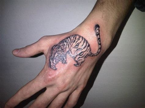 Small Tiger Tattoo On Hand Small Tiger Tattoos For