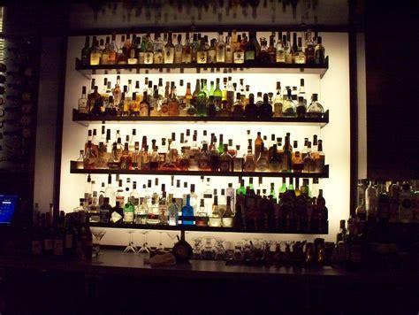wall bar file liquor bottles on a bar wall jpg wikimedia commons