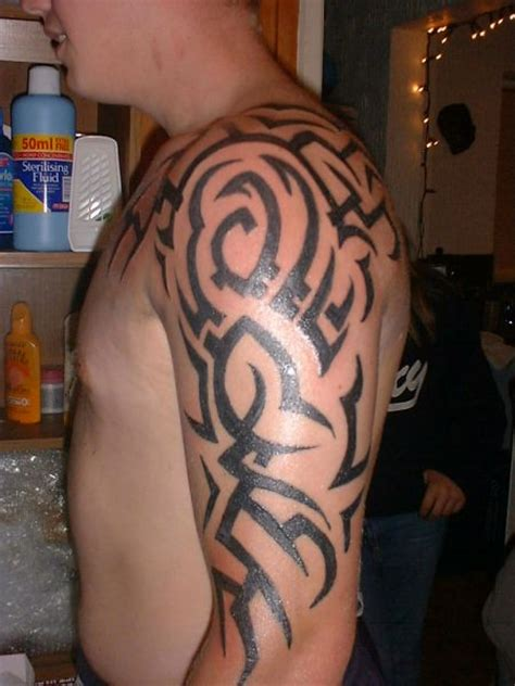 tribal chest to arm tattoo awesome tribal chest and sleeve fresh ideas