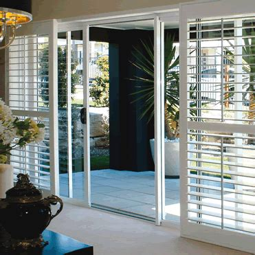 Plantation Shutters On Sliding Doors Beach House Inspo Indoor Shutters For Sliding Glass Doors