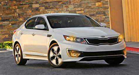 a hybrid faceoff kia optima and ford fusion shifting gears