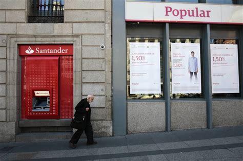 sucursales de banco popular santander vende la parte de wizink popular y recupera