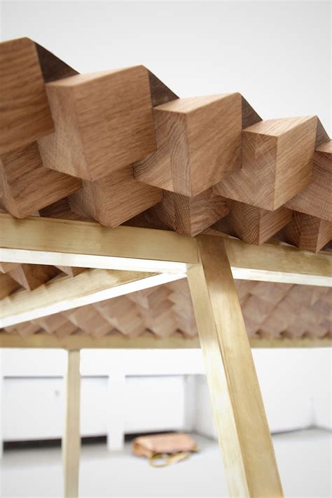 pattern is achieved when an artist the atlas table made of interlocking wooden segments is
