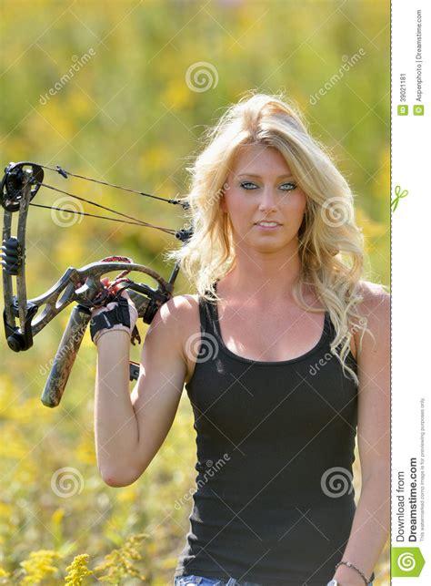beautiful videos beautiful blonde archer in field of wildflowers stock