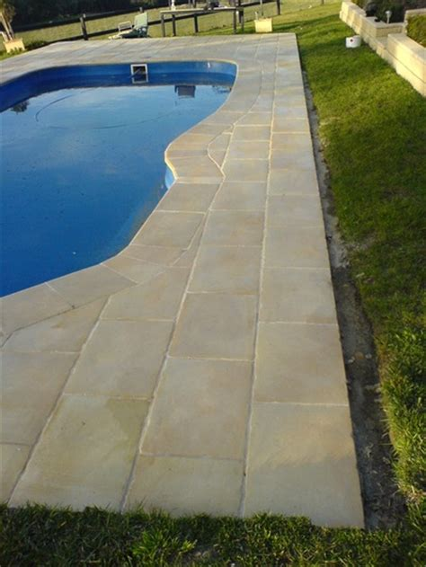 surfaces around pools in style landscapes