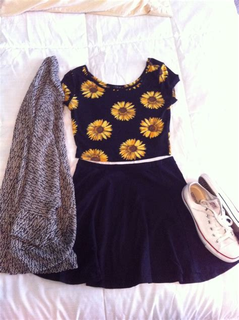 El Rajasha Top Grey sunflower crop top paired with black skater skirt gray sweater and white chucks s t y l e