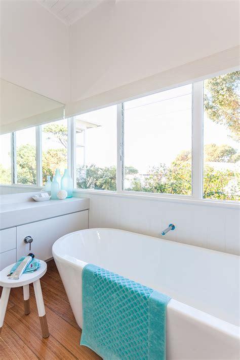 beach house bathroom serene beach house taken over by coastal beauty
