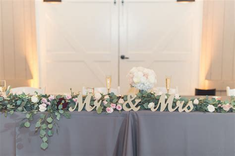 Mr. and Mrs. Head Table decor   Design by: Feathered Arrow