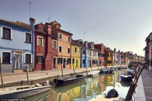 legend boats out of business on the venetian island of burano every house is a painted