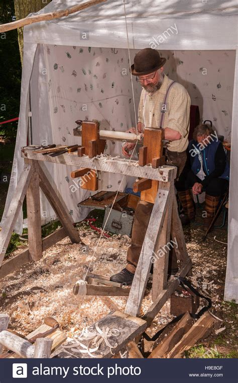 A Man Using An Old Fashioned Wood Lathe At The Royal