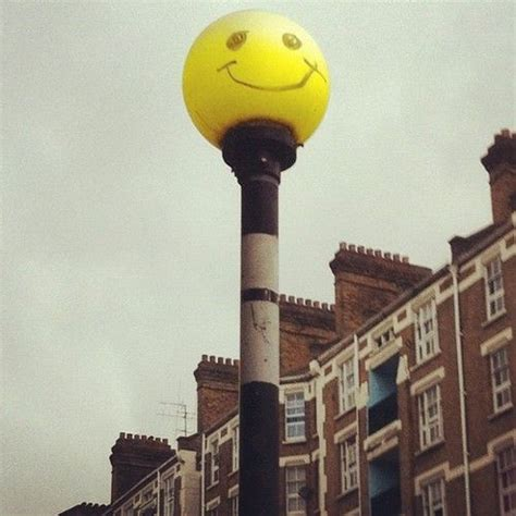 street glow strobe lights flashing smiley faced zebra crossing light street art