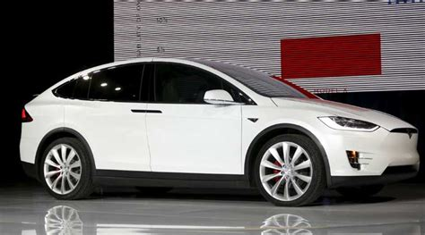 Tesla Electric Cars Cost Tesla Launches Model X Electric Suv To Take On Luxury