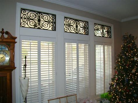 transom window coverings shades with faux iron in southlake tx traditional