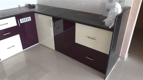 high gloss purple and kream colour modular kitchen in