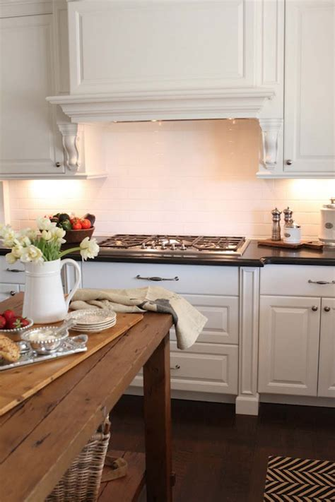 Salvaged Wood Kitchen Island by Paneled Range Hood Transitional Kitchen The Willows