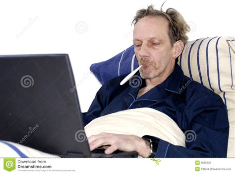 in bed workaholic sick in bed with laptop stock image image