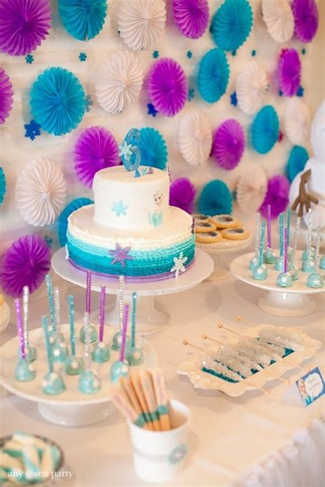 frozen themed birthday decorations sweet table from a frozen birthday party via kara s party