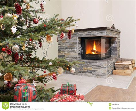 christmas tree by the fireplace stock image image 34100609