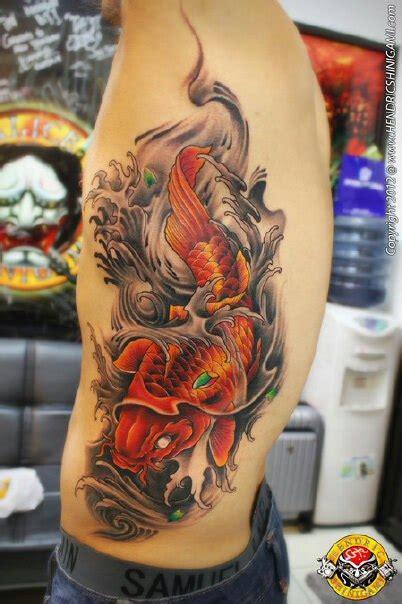 koi fish tattoo meaning swimming up or down koi swimming by bengkel168 on deviantart