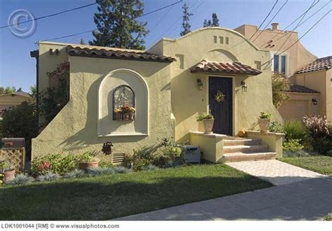 spanish exterior house designs front exterior one story spanish style house with potted plants ldk1001044 gt stock