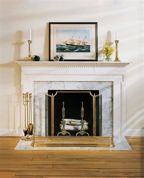 white fireplace mantel with fireplace accessories solid