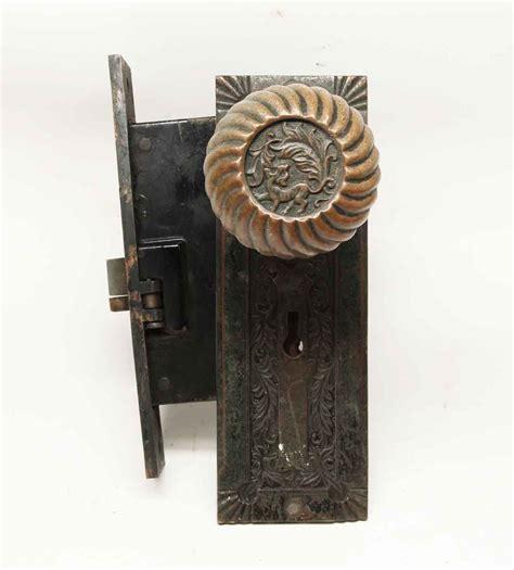 antique corbin fanciful beast bronze knob lock set