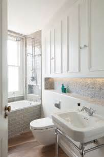 houzz small bathrooms powder room traditional with crown molding beige walls