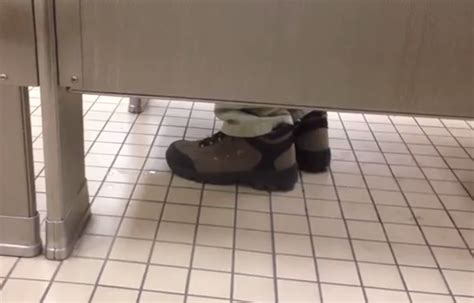 feet under bathroom stall tapping your foot in a bathroom stall well gentleman i
